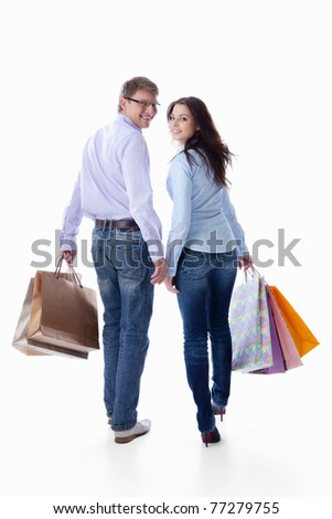 Couple with bags on a white background - stock photo