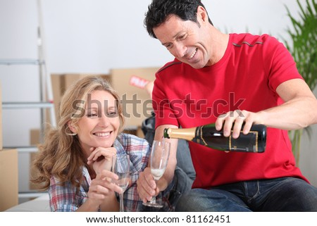 couple with champagne - stock photo