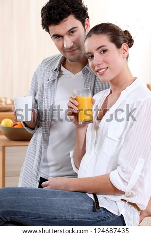 Couple with drinks at home - stock photo