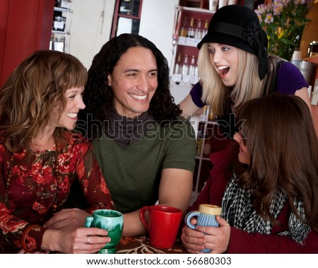 Couple with female friends at a bistro - stock photo