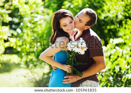 couple with flowers - stock photo
