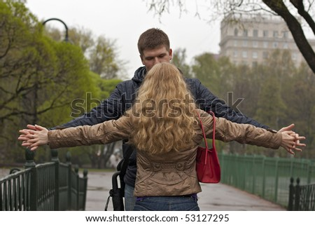 couple with flying hands outdoors - stock photo
