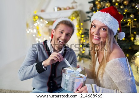 Couple with gift at home - stock photo