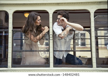 Couple with heads out the train window. Love - stock photo
