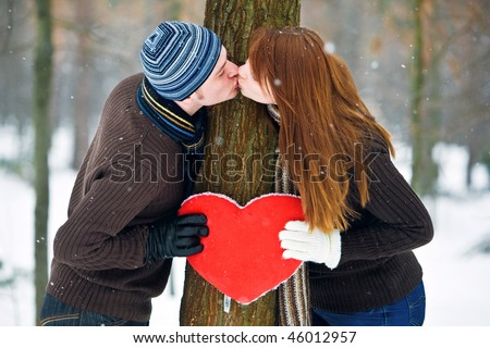 Couple with heart kissing - stock photo