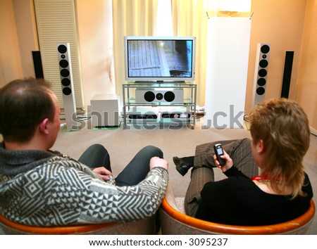 couple with home theater - stock photo