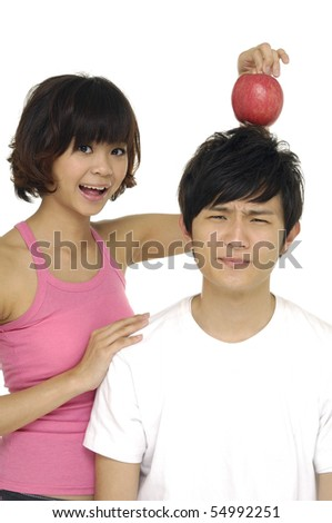 Couple with man with apple on head