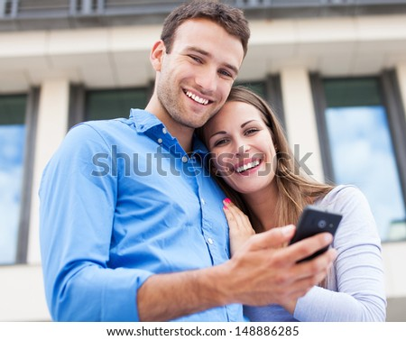 Couple with mobile phone - stock photo