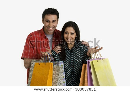 Couple with shopping bags