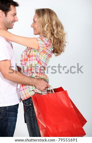 couple with shopping bags - stock photo