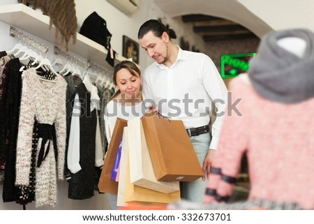 Couple with shopping bags at clothing shop together