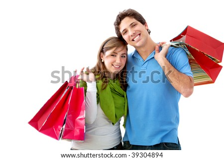 couple with shopping bags isolated on white - stock photo