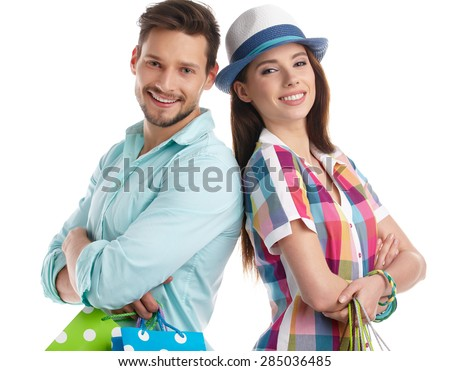 Couple with shopping bags. Studio shoot - stock photo