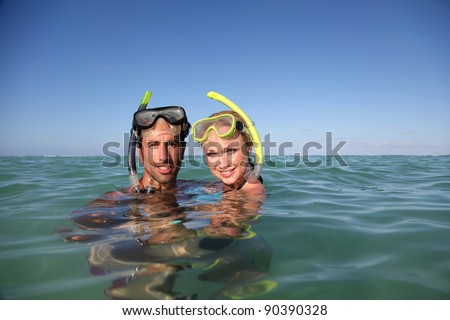 Couple with snorkeling equipment - stock photo
