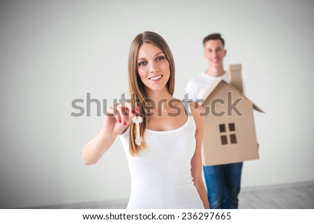 Couple with the keys of new house - stock photo