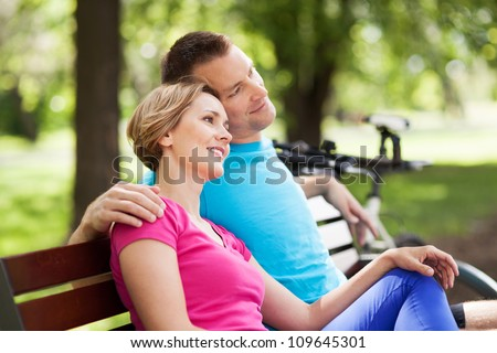Couple with their bikes in a park - stock photo