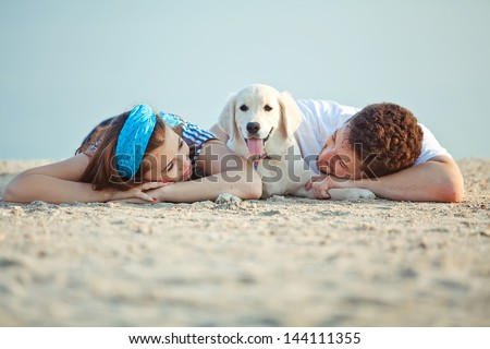 Couple with their dog - stock photo