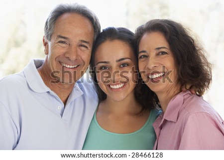 Couple With Their Teenage Daughter - stock photo