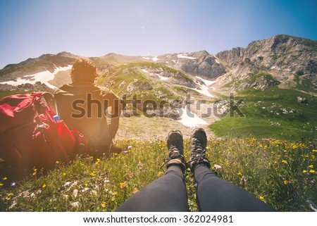 Couple Woman Feet and Man relaxing outdoor Travel Lifestyle and relationship concept mountains on background Summer vacations - stock photo