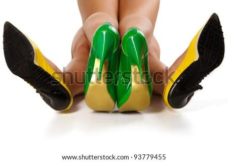 Couple women`s legs isolated on white background - stock photo