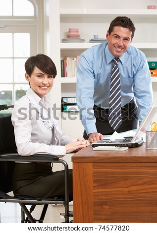 Couple Working From Home Using Laptop - stock photo