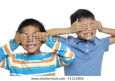Couple Young boy with hands on his eyes - stock photo