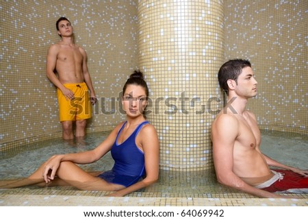 Couple young in cool spa water round pool after sauna therapy - stock photo