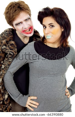 couple young people dressed as clowns, isolated - stock photo