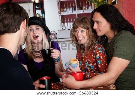Couples and good friends chat in a cafe - stock photo