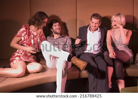 Couples at a nightclub. - stock photo