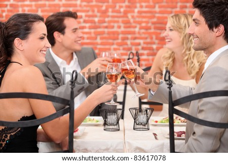 couples clinking  glasses - stock photo