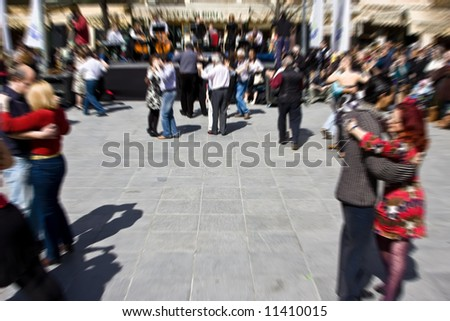 Couples dancing in tango street festival - stock photo