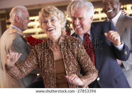 Couples Dancing Together At A Nightclub - stock photo
