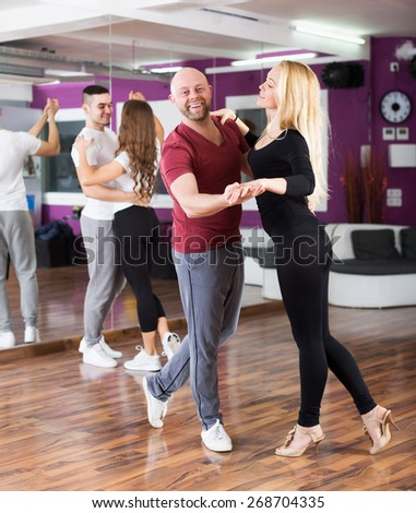 Couples enjoying of partner dance and smiling - stock photo