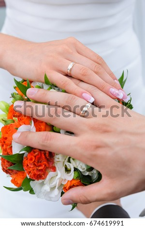 Couples hand wedding rings stock photo 674619991 shutterstock couples hand with wedding rings junglespirit Images