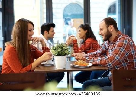 Couples having a date in cafeteria. - stock photo