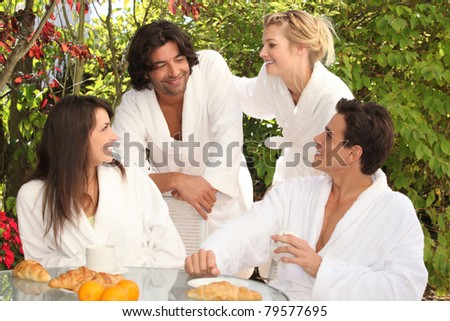 Couples having brunch together - stock photo