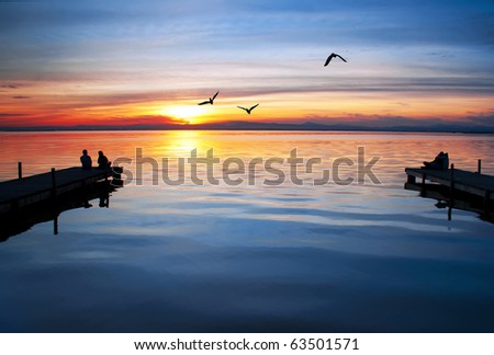 couples in the lake - stock photo