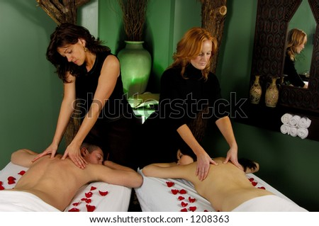 Couples Massage at Mind and Body Boutique - stock photo
