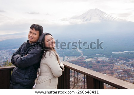 Couples on background of Mount Fuji. - stock photo