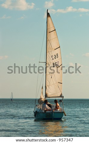 Couples, sail and sea - stock photo