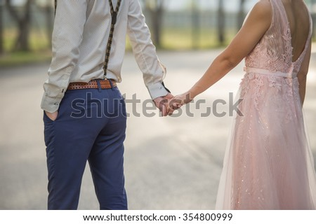 Couples walk hand in hand