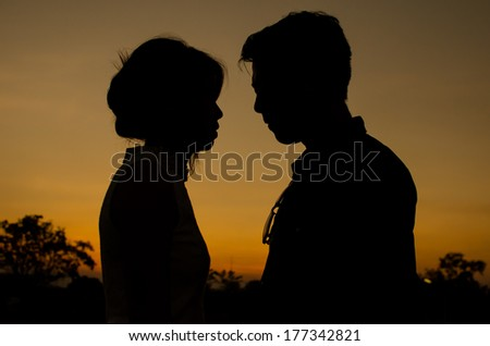 Couples with the sunset - stock photo