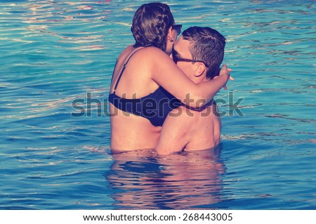 Coupling cuddling in pool with a vintage look