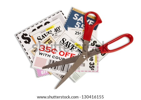Coupons With Red Handled Scissors Isolated On White  Close Up Please note...coupons showing are not real. They are fake.  There is no copyright. - stock photo
