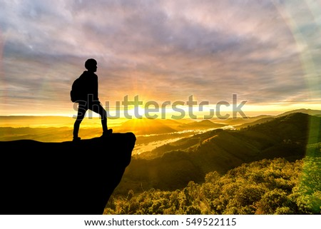Courage traveler man on top of mountain ,Success business concept
