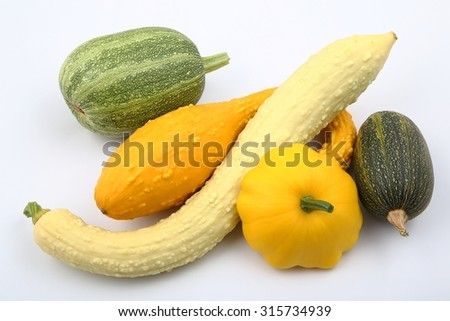 Courgettes and squash on a white background. - stock photo