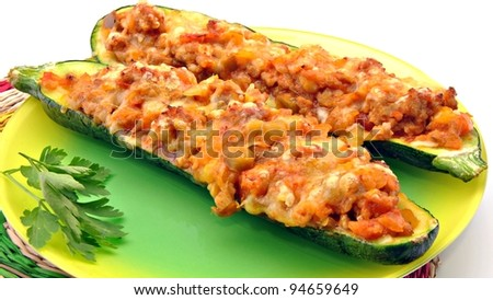 Courgettes stuffed with meat and bechamel sauce with vegetables
