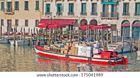 courier boat full of parcels in Venice, italy