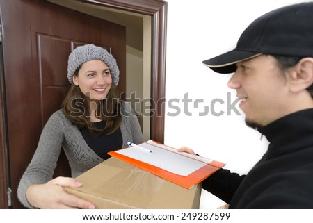 Courier Delivering a Package to a happy woman - stock photo